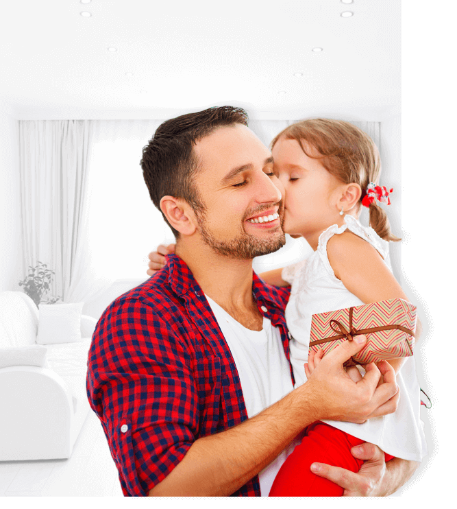 young girl kissing her father