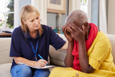 woman talking to a snenior woman